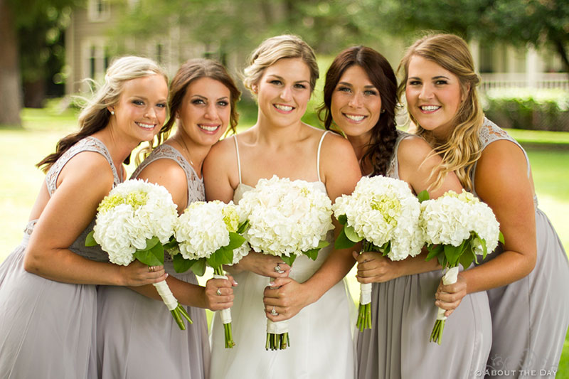 Bride and her girls get closeup with white flowers