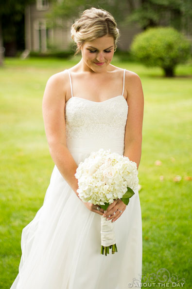 Bride in white with white flowers