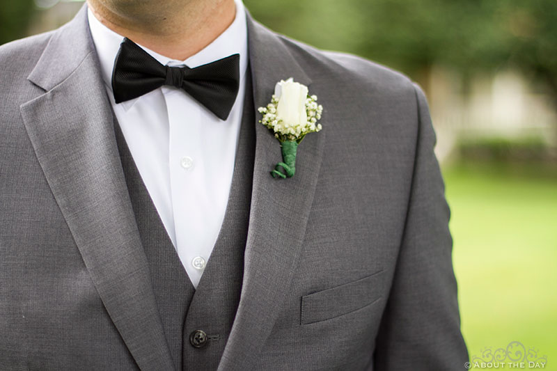 Groom in gray with white flower