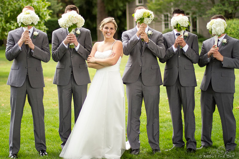 Cute Bride with guys hiding their faces behind flowers