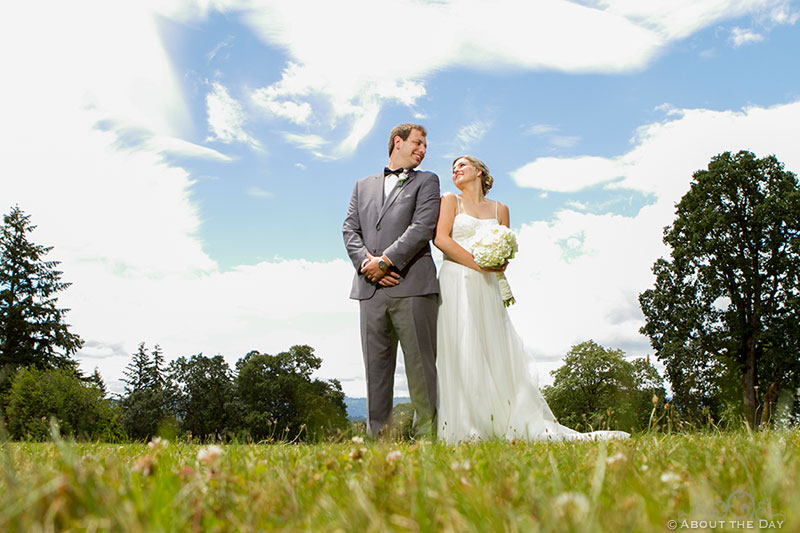 Bride and Groom stand tall with blue sky at Officers Row