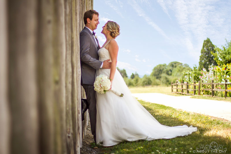 Bride and Groom stand along old log wall at Fort Vancouver