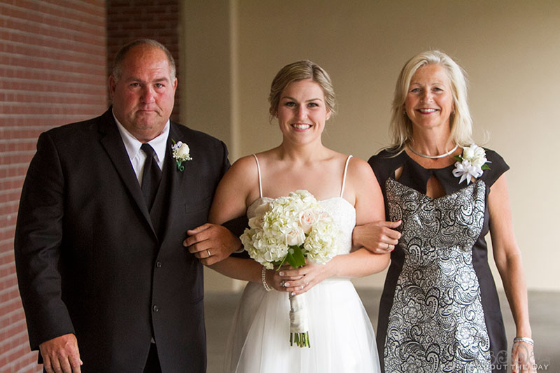 Bride walked down the isle with mom and dad