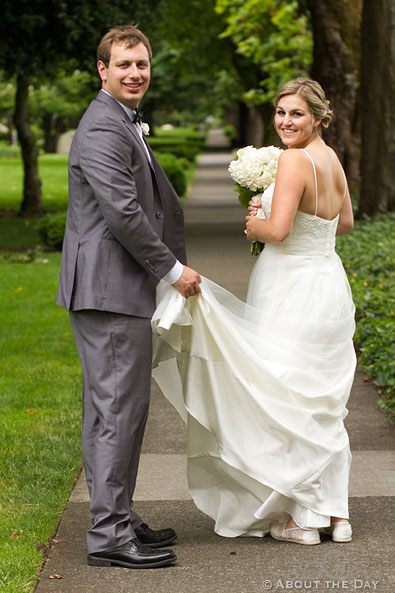 Bride and Groom turn back along path at Officers Row