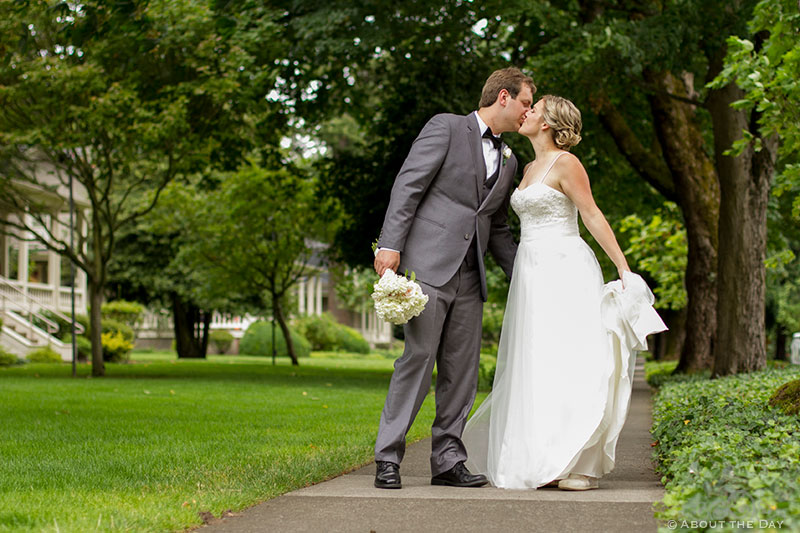 Bride and Groom kiss along path at Officers Row