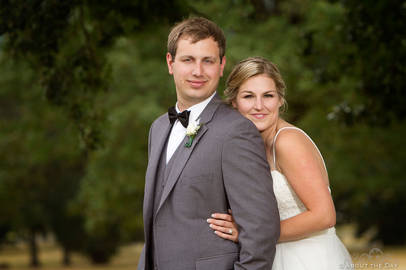 Bride and Groom pose in field at Officers Row
