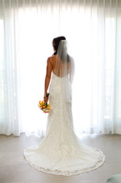 Bride stands with her back to the camera for a full dress picture in Avalon, California
