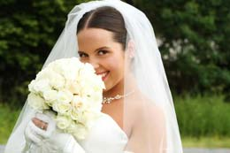Bride smells her flowers
