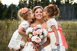 Flowergirls kiss the bride