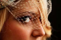 Brides eyes though fishnet
