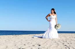 Bride stands on the New Jersey beach