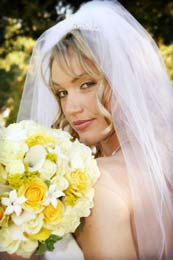 Beautiful blond Bride raises her eyebrows