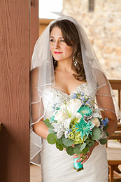 Bride looks out her window at Cheyenne Mountain Resort