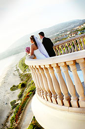 Bride and Groom look at the ocean in Dana Point