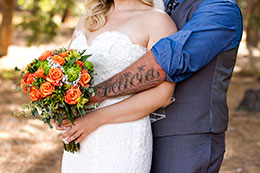 Groom shows his new tattoo of wife's name