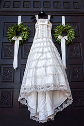 Brides dress hangs on the church doors