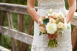 Brides lovely boquet held in front of her