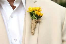 Grooms yellow flowers