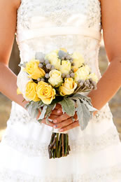 Brides dress and lovely yellow flowers