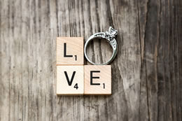 Love spelled with scrabble and a diamond ring