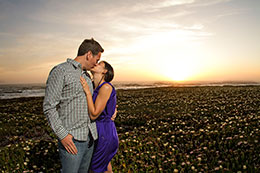 Engaged couple kisses at Piegon Point Lighthouse