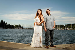 Engaged couple poses on Olympia waterfront