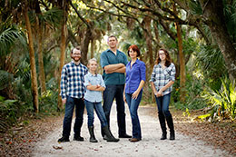 The Akeurst family stands along a road at the Koreshan State Historic Site in Estero, Florida