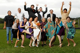 Wedding family all jumps up in Princeville, Hawaii