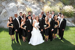 Wedding party poses between the boulders in Palm Desert