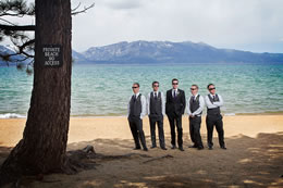 Wedding guys stand by Lake Tahoe