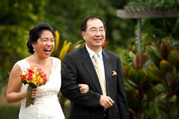 Wedding Photography Bride laughs as she walks down the isle with her father