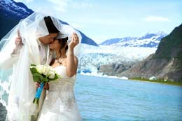 Bride and Groom kiss in front of Mendenhall Glacier in Juneau, Alaska