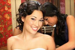 Bride poses as she gets ready