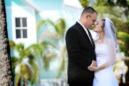 Bride and Groom nussel in front of Florida house