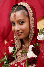 Indian Brides beautifl face in red cover at the Park Hyatt in Dubai