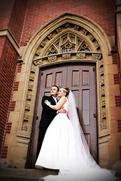 Bride and Groom stand at the doors of Blessed Sacrament in Seattle
