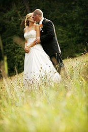 Bride and Groom pose along the railroad tracks in Minturn Colorado
