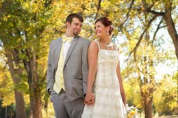 Bride and Groom pose under yellow trees