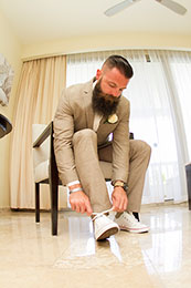 Bearded Groom finishes tying his shoes