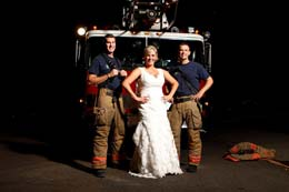 Bride poses with sexy firemen