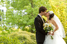 Wedding couple kisses in the garden at the Harbor Club