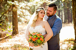 Bride and Groom lit by the sun in the forest