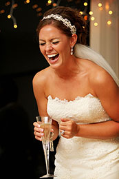 Bride laughs hysterically at the best man toast
