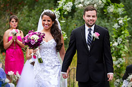 Newly married couple walks down the isle at Dragonfly Retreat