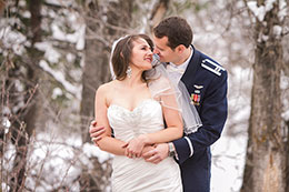 Air Force Wedding Couple Kiss in Snow Near Colorado Springs