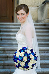 Bride smiles on the steps of the Legislative Building in Regina