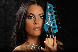 Sexy blue eyes with blue Ibanez Guitar