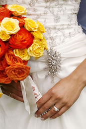Bridal dress, orange and yellow flowers, and jewlery