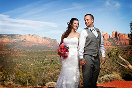 Bride and Groom with Red Rock Park in the background