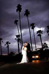 Bride and Groom kiss beneath an ominous sky